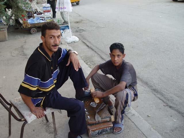 Shoe Shine Boy With Customer